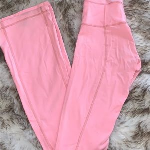 Pink LuluLemon flared yoga pants